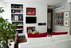 Wall mounted tv with shelves and cupboards