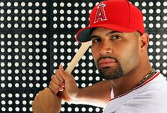 Albert Pujols , is a Dominican-American professional baseball first baseman for the Los Angeles Angels of Anaheim of Major League Baseball.  He is the only player in major league history to bat at least .300 with 30 or more home runs and 100 or more runs batted in in his first 10 seasons.