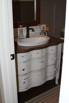 bathroom vanity from dresser. I like the raised sink