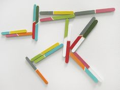 DIY Magnets using popsicle sticks. (you could do anything! colors, words, compound words, numbers . . . )