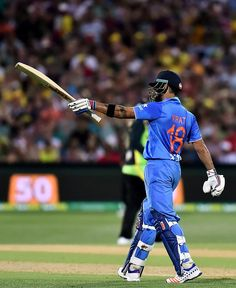 Virat Kohli brought up his International half-century, his first against Australia. Virat Kohli Beard, Virat Kohli Instagram, Virat Kohli Wallpapers, Virat And Anushka, Cricket Wallpapers, World Library, Blue Army, Cricket Score, Mumbai Indians