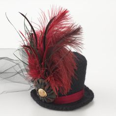 Fascinators or Small clip-on hats decorated with feathers, ribbon, flowers, veils, beads, cameos, lace, sequins and other embellishments. Any colour or colour combination. Plain DIY mini hats are ok too. Example: Black & Red Mini Top Hat, $30.00