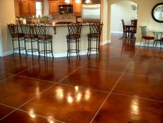 wood kitchen cabinets stained concrete floors Acid Stained
