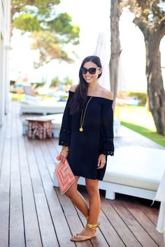 f6574a6fed4 Kat Tanita of With Love From Kat wears a Vava black off the shoulder dress  with