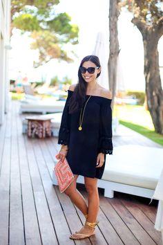Black off the shoulder dress.