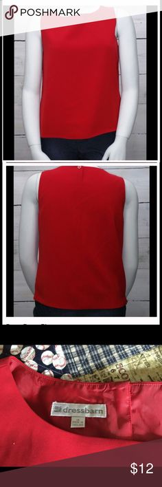 """Red Sleeveless Blouse 🔄 RE POSH🔄 This fully lined brilliant red sleeveless blouse is perfect to go from the office to a night out.  Unfortunately it does not fit me right.  Single button closure in back. Bust measures 21"""" flat. Shell & lining 100% polyester. Dry clean (first two pictures from original listing). Dress Barn Tops Blouses"""