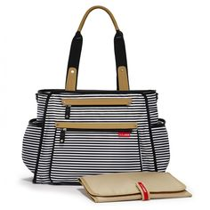 The Skip Hop Grand Central Baby Changing Bag in Black & White is a compact and modern changing bag, that magically holds more than you could ever imagine!