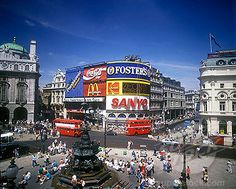 Piccadilly circus, West end, London    One of the coolest things I've ever witnessed happened here, and it all had to do with love.  The love of a couple of punk rockers who'd not seen each other in far too long, and the love of two elderly people who'd seemingly never spent a day apart.  Just beautiful.  Just standing on a corner, watching people go by.  Wonderful.  I love London so much.