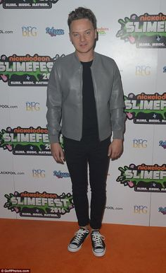Looking good: Conor Maynard kept it stylish in a grey leather jacket over an…