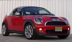 A three-quarter front view of a red 2012 Mini Cooper S Coupe