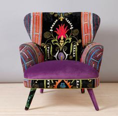 Vintage Suzani fabrics dress this wingback chair by Name Design Studio