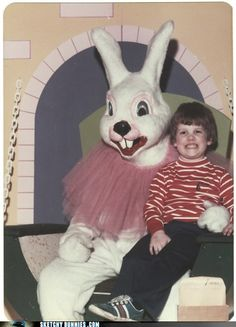 the only thing more disturbing than a crying baby with a bunny is a child with a fixed grin.