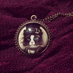 Monocle Cat Necklace, £8.00. This steampunk inspired Monocle Cat necklace features a vintage style brass chain holding a domed pendent with a smart Monocle wearing kitty inside complete with top hat!  There are two styles to choosefrom including black and white andtabby kitty.  The chain measure approx 25cm across the full length with a 6cm optional extension chain.  The pendent measures 3.2cm in diameter.