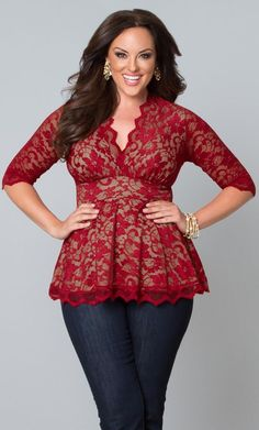 Beautiful crimson red and nude lace top with her dark hair and eyes, paired with gold jewelry and dark jeans.