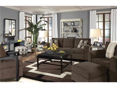 Living Room Colors For Brown Couch these light hardwood floors contrast dark brown furniture. the