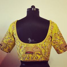 Beautiful yellow color designer blouse with elephant and floret lata design hand embroidery thread work. For Price and Other details reach at 044-42179088 or Whatsapp: 7010905260. 18 September 2017