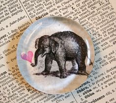 Valentine cutie!  Baby elephant blowing love glass magnets.  Great for party favors, too.... by CrowBiz