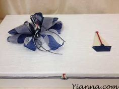 """Nautical"" Box 23 1/2"" x 13 1/2"" x 4"" very hard glossy white box covered top with netting to match the Nautical candle $58.00"