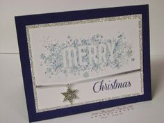 "The Thumping technique was used on this card. The ""Merry"" from Seasonally Scattered stamp set was inked with Soft Sky ink, and then Marina Mist and Night of Navy markers were tapped (the brush end) all over the stamp itself before stamping on the Whisper White card stock. All is Calm Snowflake embellishment was added with a piece of 1/8"" silver ribbon. The greeting (from Watercolor Winter) was stamped in Night of Navy. A layer of Silver Glimmer Paper was added to add a bit more bling."