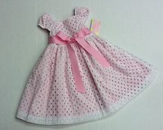 White eyelet girl's dress. By Plum Pudding. Button back, sash ribbon tie.  New with tags, sizes 4T to 6X. $24.99