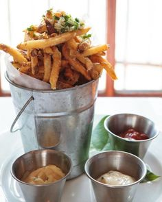 - Savory fries with a selection of gourmet dips,is a nice pairing with your happy hour drinks! Seasoned truffle fries with three gourmet dip choices: garlic aioli, truffle mayo, and chipotle ketchup Bistro Food, Pub Food, Cafe Food, I Love Food, Good Food, Yummy Food, Menue Design, Truffle Fries, Gastro Pubs