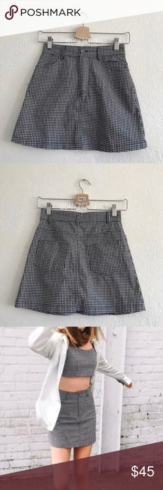 "Brandy Melville Juliette Gingham checkered skirt Brandy Melville Juliette gingham skirt Fitted skirt in gingham with a button and zipper closure front, side and back pockets. New without tags  Fabrics: 97% cotton, 3% elastane Measurements: 15"" length, 23"" waist Brandy Melville Skirts"