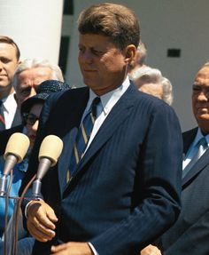 Pure Prep: John FItzgerald Kennedy in blue pinstriped suit, white point-collar shirt, blue and gold repp striped tie; circa 1960