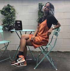 orange silk slip layered over a black t-shirt paired with black and orange sneakers. Visit Daily Dress Me at dailydressm Trendy Outfits, Girl Outfits, Summer Outfits, Cute Outfits, Fashion Outfits, Womens Fashion, Fashion 2018, Urban Fashion Women, Fashion Online