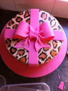 Leopard print cake with pink bow