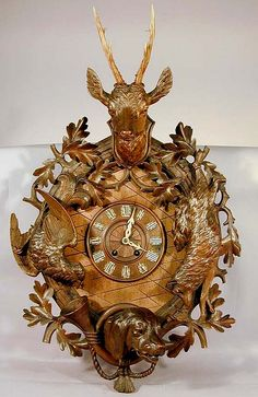 grandiose carved wall clock with fox, partridge, stag head and dog head, swiss brienz 1900