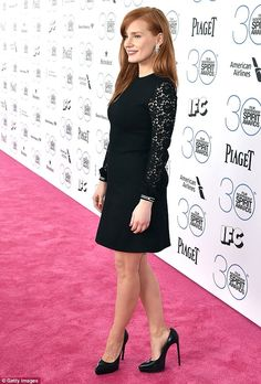 Sophisticated: Jessica Chastain looked glamorous in a black dress with lacy sleeves as she...