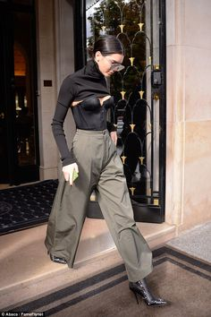 Strange look: The supermodel proved herself to be at the height of high fashion as she stepped out of the plush George V Hotel wearing a sexy bustier with a cropped jumper attachment Fashion Line, Cute Fashion, High Fashion, Fashion Outfits, Paris Fashion, Fashion Fashion, Womens Fashion, Kardashian, Cuerpo Sexy