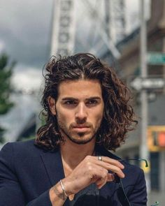 A list of curly hairstyles for men which inlcudes how to style curly hair men, curly hairstyles for black men, haircuts for men with wavy hair, and more. Long Curly Hair Men, Long Brown Hair, Guys With Curly Hair, Long Hair Guys, Boys With Long Hair, Brown Hair Men, Men Hair, Hair And Beard Styles, Curly Hair Styles