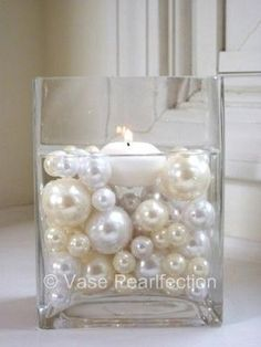 Pearls in glass candle votive art deco roaring great gatsby party theme wedding shower Not a fan of floating candles, but this looks ok.a place to mix the golds. Gatsby Wedding, Our Wedding, Dream Wedding, Wedding Champagne, Wedding Garter, Chic Wedding, Lace Wedding, Elegant Wedding, Wedding Stuff