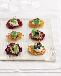 For a finger-friendly take on classic beet and goat cheese salad, serve fried beet chips topped with a dollop of the tangy cheese and vinaigrette-laced micro greens. They make perfect hors d'oeuvres -- crispy instead of juicy beets means no one will be caught red-handed.