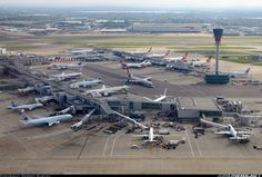 London Heathrow Airport. I spot a Virgin Atlantic A340-500, three VA A340-600s, two VA 747s, an Egypt Air 777-300, an AA 777-200, an Air Canada A330, an AA 767, a Finnair A319, an Air Canada 767-300, a BA A318 in the distance, another Air Canada 767 on the right, and three aircraft I don't recognize.