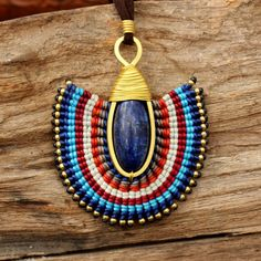 Hey, I found this really awesome Etsy listing at https://www.etsy.com/listing/159481674/tribal-design-necklace-with-waxed-cotton
