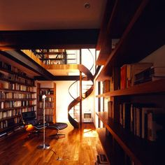 My splurge... a library.  Take away the bookshelf on the right, add in some stained glass behind the staircase and some more windows and tables to the right.