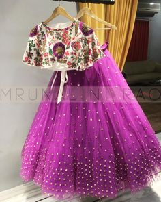 Beautiful purple color lehenga with floral crop top from Mrunalini Rao. mail on enquiry. Frocks For Girls, Dresses Kids Girl, Kids Outfits, Kids Dress Wear, Kids Gown, Baby Dress Design, Frock Design, Lehanga For Kids, Kids Lehanga Design