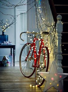 Bike with fairy lights (Forest Festival) from a blog about 2013 Christmas decoration trends by John Lewis http://www.4manchesterwomen.co.uk/wonderful-homey/new-trends-christmas-decorations/