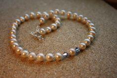 This mother has got two sons. Freshwater pearls. Handmade by Goldsmith Sanna Hytönen, Suolahti. http://www.kultaseppasannahytonen.com/