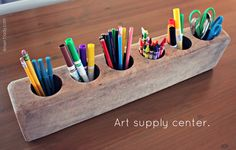 Drill holes with large drill attachment into a rustic piece of wood- easy peezy art station