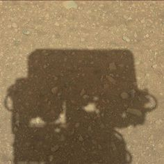 Twitter / MSL_101: Curiosity's shadow on the surface of Mars.