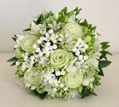 Pale green and white bouquets of rose, freesia, agapanthus, bouvardia and lisianthus with mixed foliages