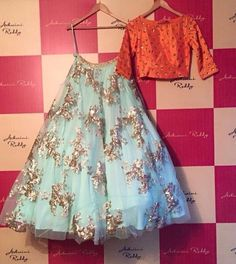 Fabulous light blue net lehenga choli which is radiantly made with embroidery work and patch border work. Comes with matching orange crop top. Pakistani Dresses, Indian Dresses, Indian Outfits, Indian Clothes, Kids Lehenga Choli, Indian Lehenga, Sarees, Indian Attire, Indian Ethnic Wear