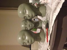 Painting styrofoam heads for hat display