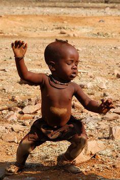 Himba baby performing a Himba dance.
