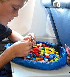 Lay-n-Go Lego mat & tote  I had a thot one day, that this was a necessary thing as my kids travel with their favorite toy. Lo & behold it already exists. Is there a way to make it a bit bigger to drape onto the kids lap so the Lego pieces are not under the airplane seat?