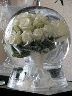 Rose bouquet ice sculpture globe http://www.sweetcandytablesbuckinghamshire.co.uk/ice-sculptures/4588787447
