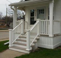 Front porch columns w shorter stair posts.